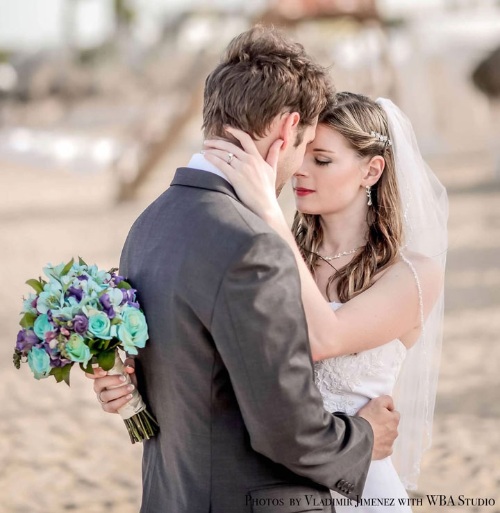This is a couple in love at their wedding. The exchanged Todd Alan braided wedding rings. The braided rings were a representation of them weaving their lives together. They choose a artistic ring. This picture shows their heads put together as they savor a moment of love