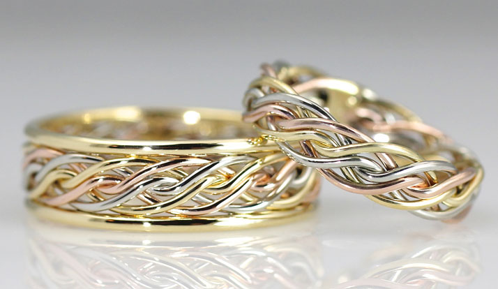 This is a tri-color wedding ring braided by Todd Alan. It is a unique wedding ring braided together with six wires in different colors.