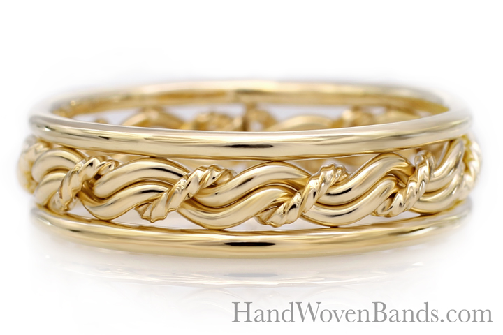 Our braided wedding ring using our cord of three braid. Handmade by artist Todd Alan. This braided ring is made in all 18k yellow gold.