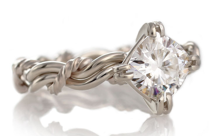 A moissanite ring made with the Christian wedding ring weave known as the cord of three ring. All rings are handmade and braided rings by Todd Alan.