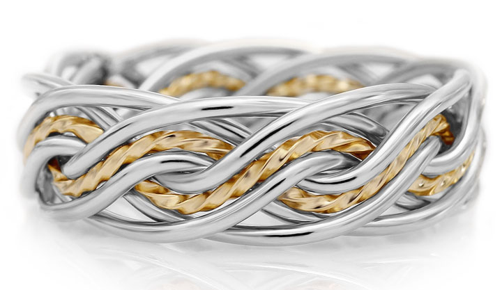This is our braided wedding ring that showcases getting your center wires made rope. This means extra twisting of the wire in the ring.. This is a two tone ring braided with eight wires.