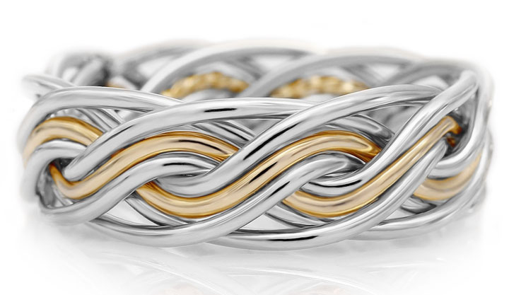 This is our braided wedding ring that showcases getting all your wires smooth. This is a two tone ring braided with eight wires.