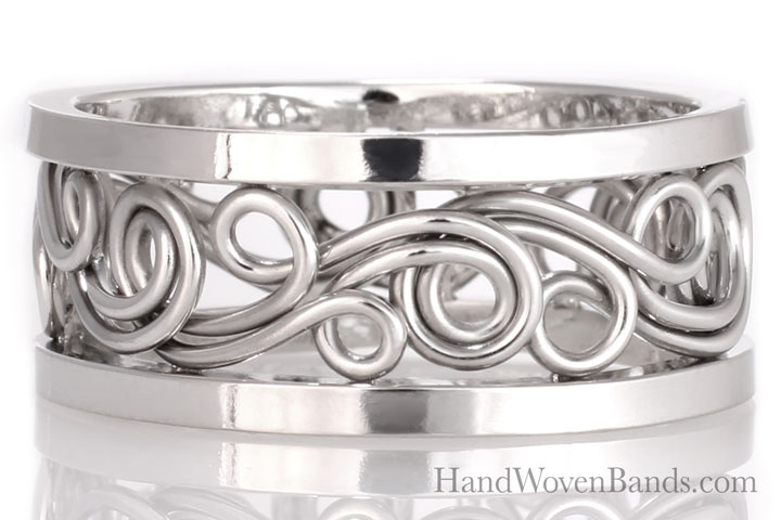 This is the first swirl ring braided with Todd Alan's signature square outer bands. This ring was made in platinum and can be customized. This braided wedding ring is good for a mans woven wedding ring.