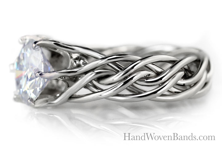 An example of our custom prong work surrounding a diamond set in our 14k white gold braided ring