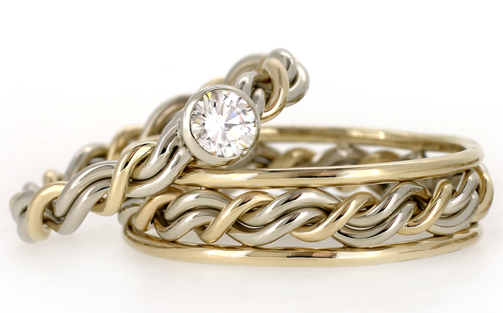 Christian wedding ring set made with Christian engagement ring set with a sweet .25ct diamond bezel set into the braided ring.