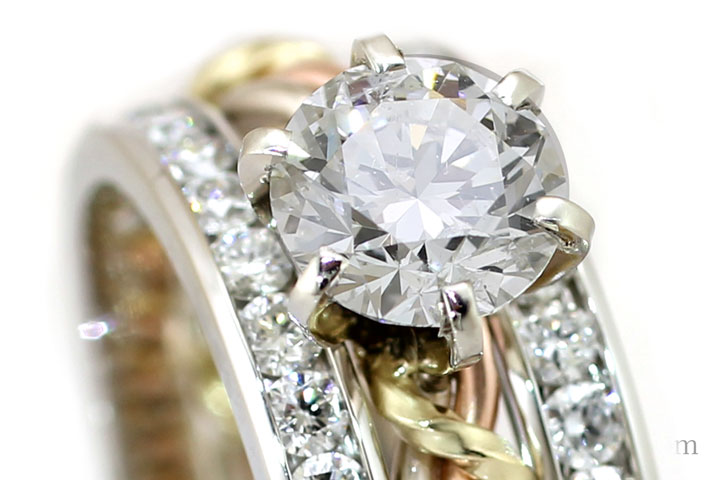 An up-close example of a diamond set in one of Todd Alan's diamond wedding bands. This ring is featured as on of our braided rings known as the cord of three ring
