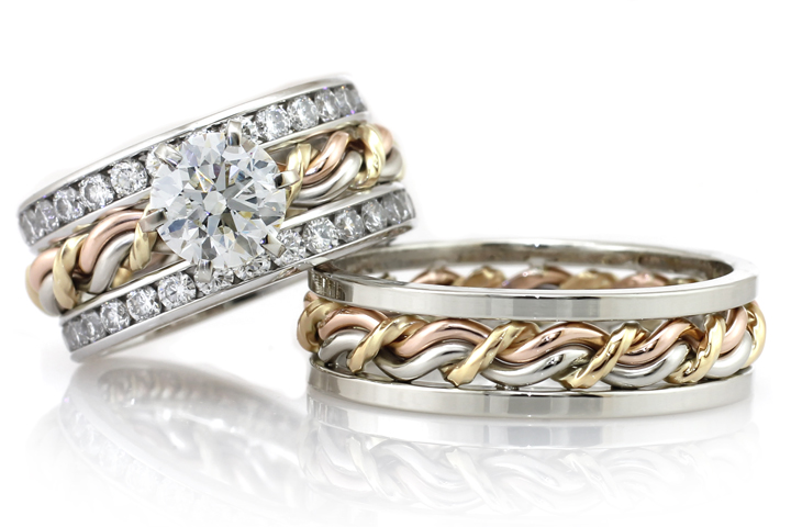 This unique braided wedding ring set is made by Todd Alan. This cord of three wedding ring set is a one of a kind example of what Todd Alan can make. Tri-tone gold and woven together with a diamond mounted to the gold of this braided ring.