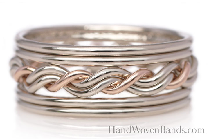 This is a white gold ring with one strand in 14k rose gold. It is a braided wedding ring with double outer bands. Todd Alan handmade this braided ring.