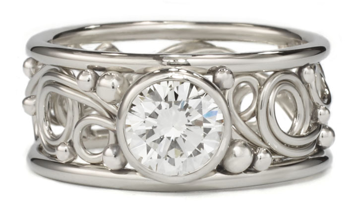 Swirl ring with a diamond handmade by Todd Alan in 14k white gold