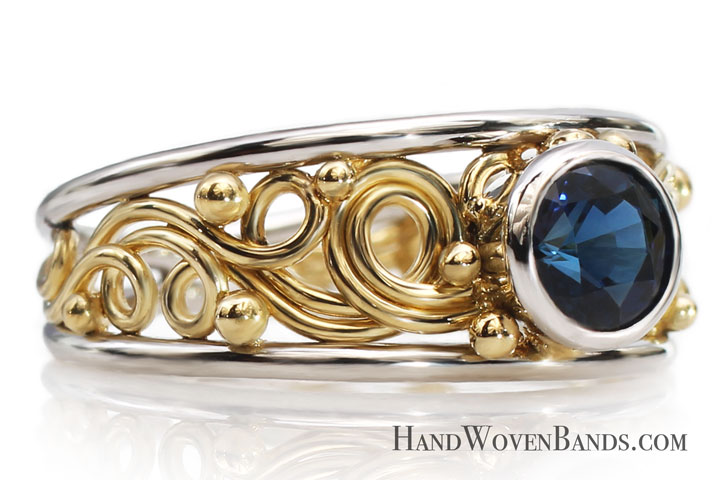 This swirl ring is a tapered artisan ring mounted with a sapphire ring. This ring was handmade by Todd Alan and is a very unique 14k yellow gold ring handmade by artist Todd Alan-this swirl ring is a woven artist ring