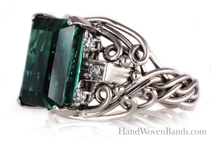A completely artisan ring. This unique ring was made with a huge tourmaline in 14 white gold. Todd made this ring by hand in his own style.