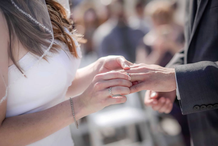 Braided wedding rings handmade by Todd Alan. This is a picture is two of our customers exchanging rings in their wedding ceremony