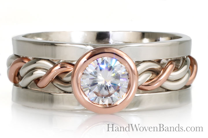 Unique braided ring bezel set with a large diamond. This is a custom made ring made in 14k rose gold and 14k white gold and square outer bands. Handmade braided wedding ring by Todd Alan