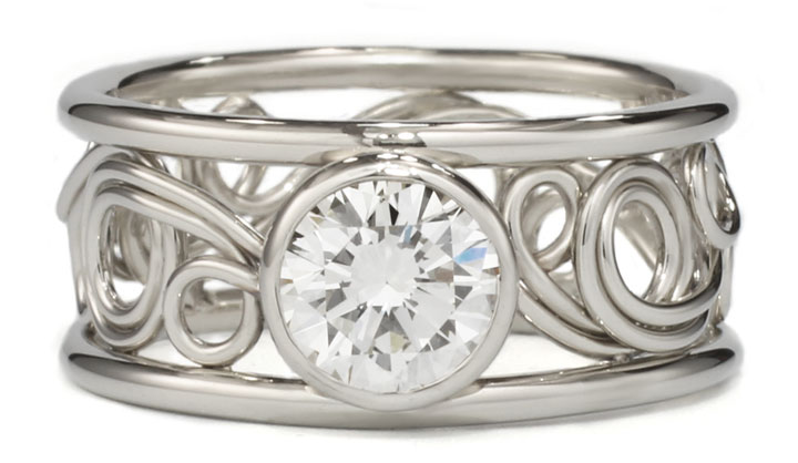 Swirl ring in 14k white gold with a diamond