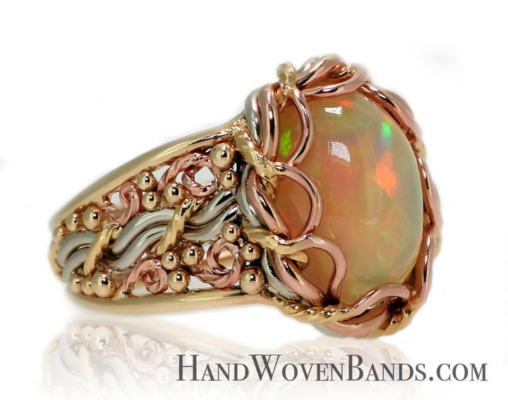 A unique artisan ring handmade with an opal. This opal ring is made with many different colors of gold. A Todd Alan original ring