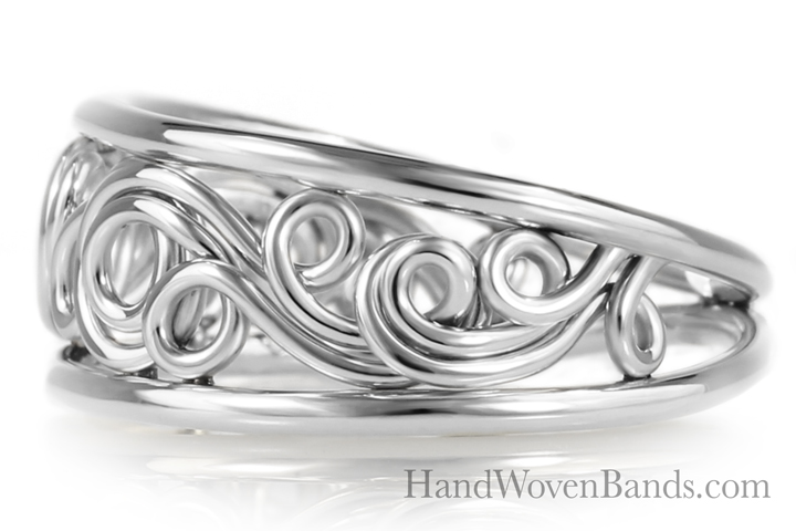 A handmade filigree ring. This swirl ring is made in all platinum but artist Todd Alan. This ring is made by hand in the swirl style and is tapered so it is easier to wear.