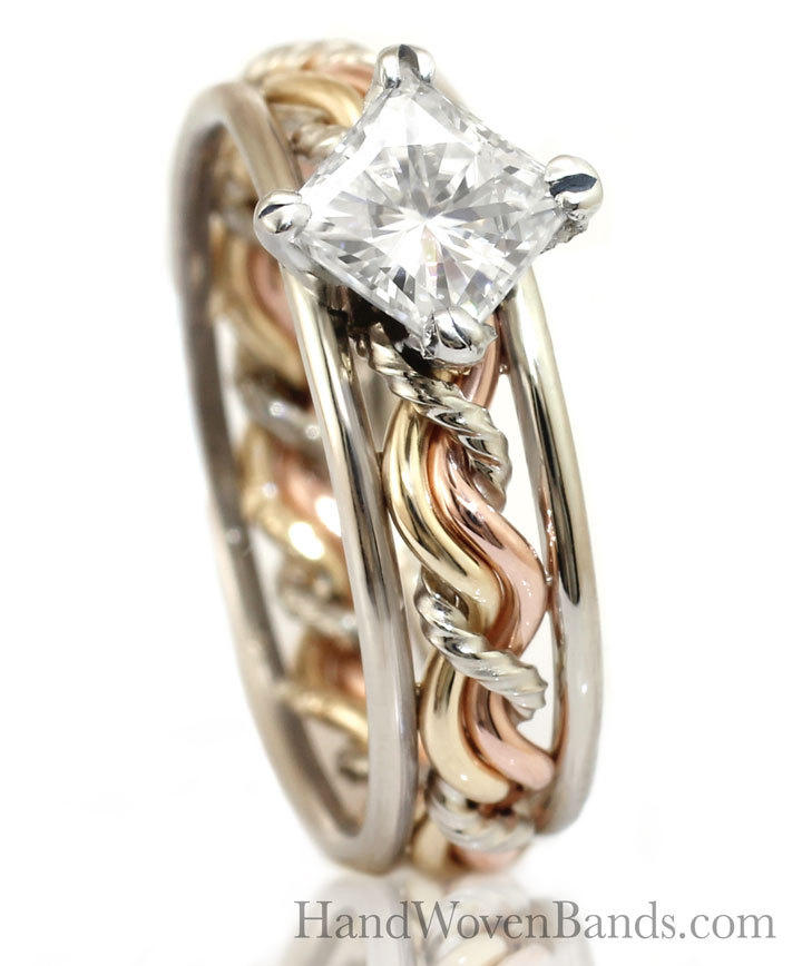 This is a braided engagement ring set with a princess cut diamond and our cord of three ring set. This has three colors and is handmade by artist Todd Alan.
