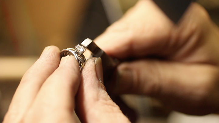 A close up of Todd Alan making his rings by hand. He is setting a diamond in one of his braided wedding rings. An example of our handmade braided rings.
