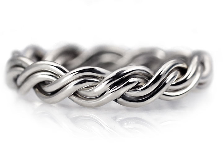 This shows our silver braided ring and the seam it may have. Since all our rings are handmade they may have a seam. They are not factory produced. This is a four strand braided ring.