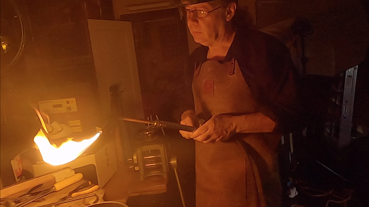 Todd Alan using a torch to work on his custom braided wedding bands. He makes all his rings by hand and this shows him mid-process making a braided ring.
