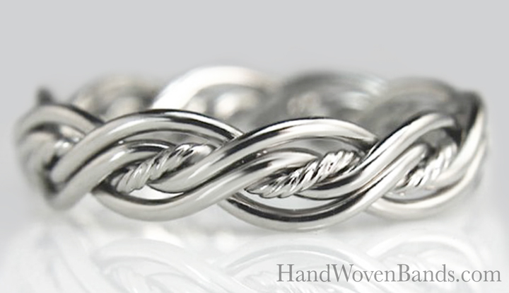 This is a braided ring that is made with platinum and the center is a rope texture which means the wire is twisted to make a nice accent to the ring. As always, this ring is handmade and a braided ring.