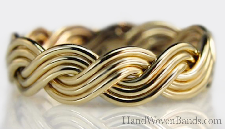 This is a robust six strand open weave braided ring in 14k yellow gold. It, like all our braids, are handmade by jewelry artist Todd Alan. This a unique wedding ring braid.