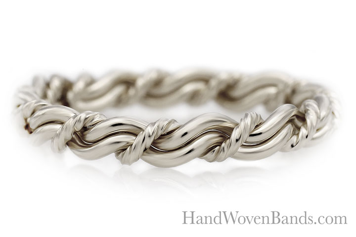 Braided cord of three wedding ring. Handmade by weaving white gold together